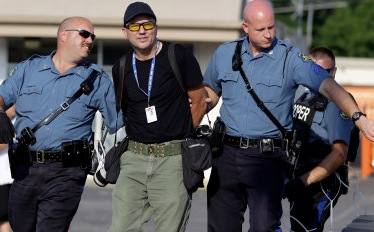 picture of ferguson police arresting a journalist doing his job