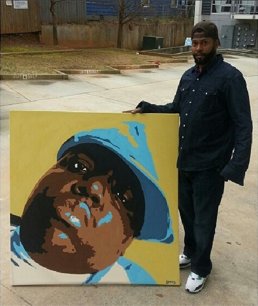 picture of doug thompkins holding his painting of the notorious big